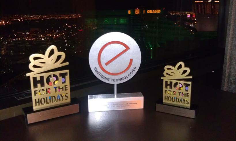 "The hardware. From right to left: Hot for the Holidays first place award in the Productivity Category for Opera Max, E-Tech Award for Opera Mediaworks ""Talk to Me"" ad format, and Hot for the Holidays 3rd place award in the productivity category for Opera Coast"